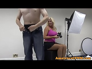 Busty CFNM amateur wanks cock at photoshoot