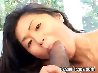 Slimy deepthroat asian on a big black cock
