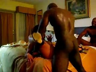 Asian wife fucks two big black dicks in hotel
