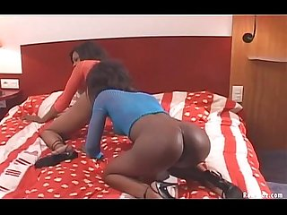 Two sexy black girls playing sex toys