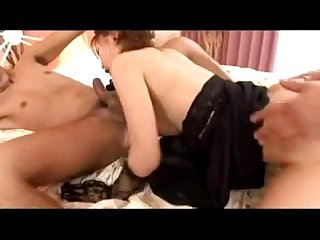 Asian Girl in Black gloves sucking cock while other guy fucking her pussy on The bed