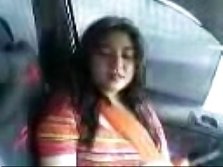 Pkistani girl in car with boyfriend