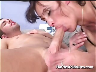 Mature lady blowing hard young cock
