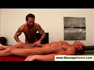 Muscled masseur puts condom on to fuck
