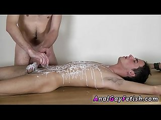 Gay video Brit lad Oli Jay is strapped down to the table, his smooth